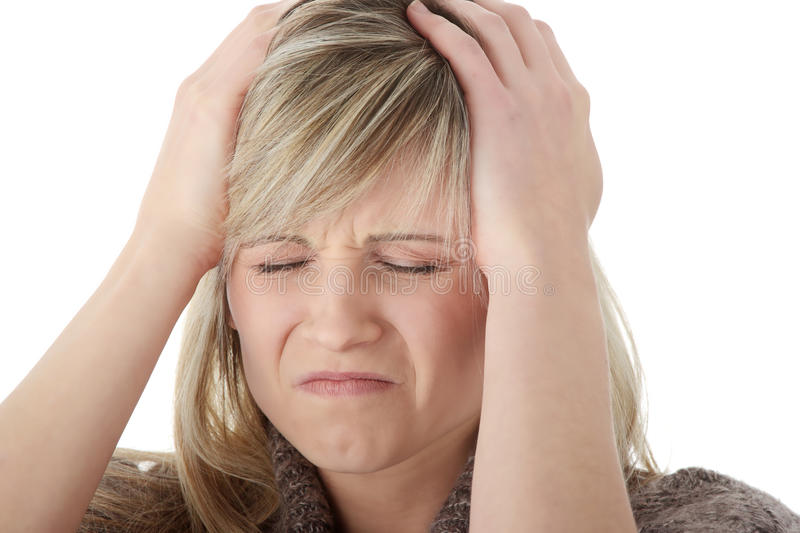 Woman with headache holding her hand to the head royalty free stock image