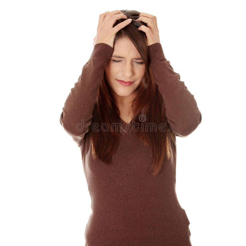 Woman with headache holding her hand to the head. royalty free stock image