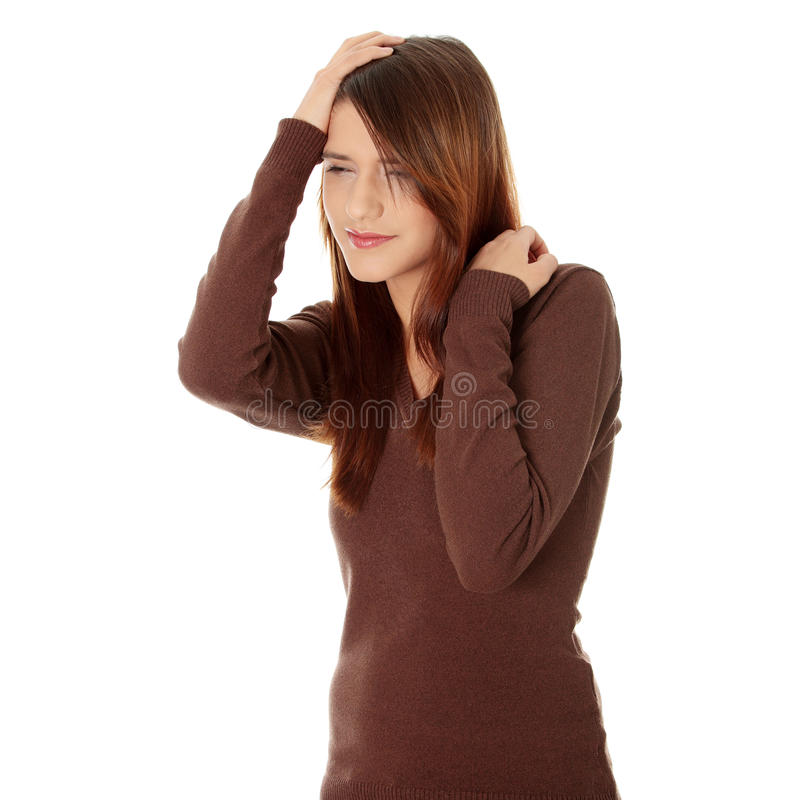 Woman with headache holding her hand to the head. stock photos
