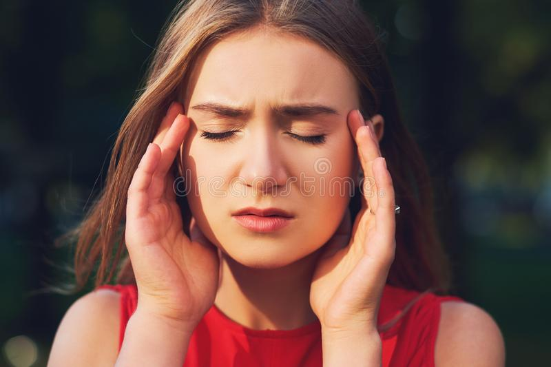Woman with headache, migraine or stress. Help, troubles in communication, overworking concept royalty free stock photography