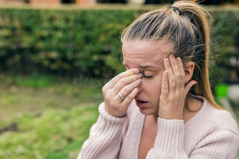 Woman with headache. Seasonal allergies and health problems. Sin royalty free stock photography