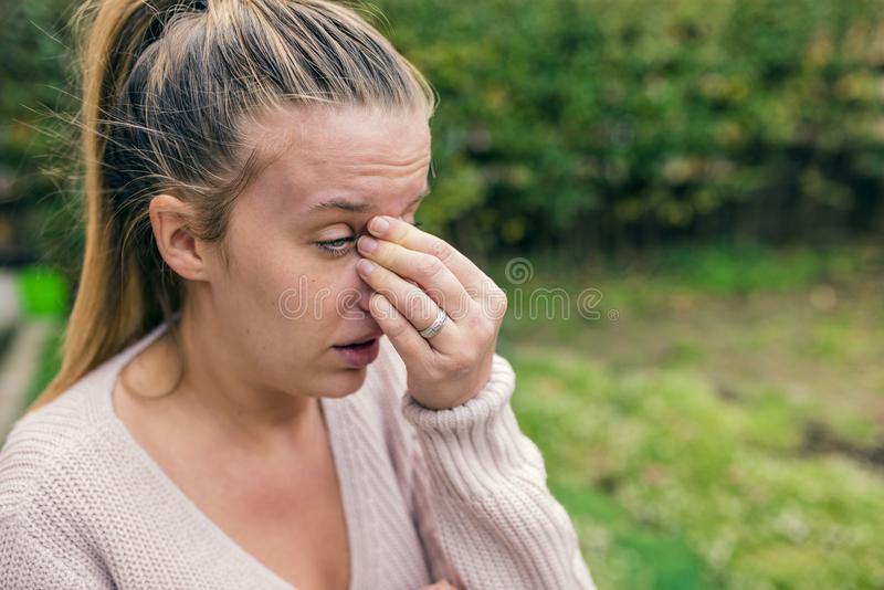 Woman with headache. Seasonal allergies and health problems. Sin royalty free stock image