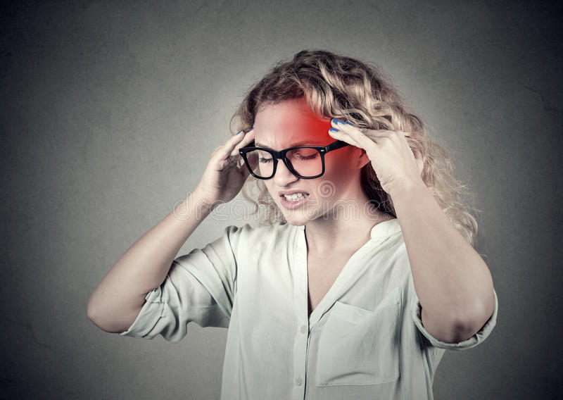 Woman with headache stress, with red alert accent stock images