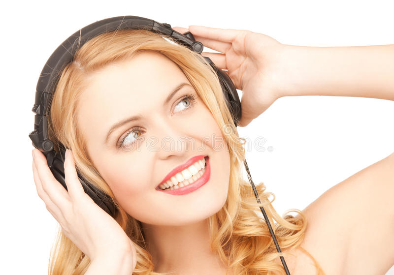 Woman with headphones. Picture of happy and smiling woman with headphones royalty free stock images
