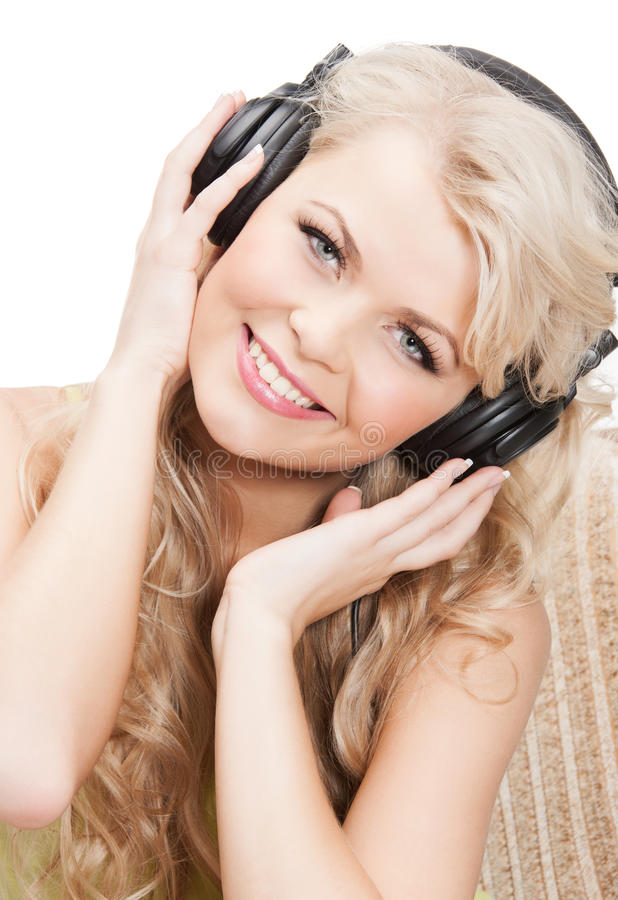 Woman with headphones. Picture of happy and smiling woman with headphones stock photography