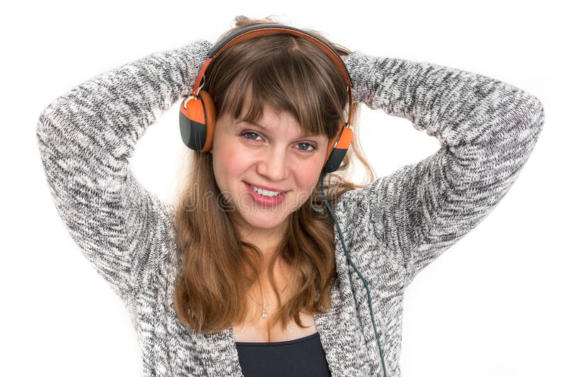 Woman with headphones is listening rock music. Pretty woman with headphones is listening rock music stock photos