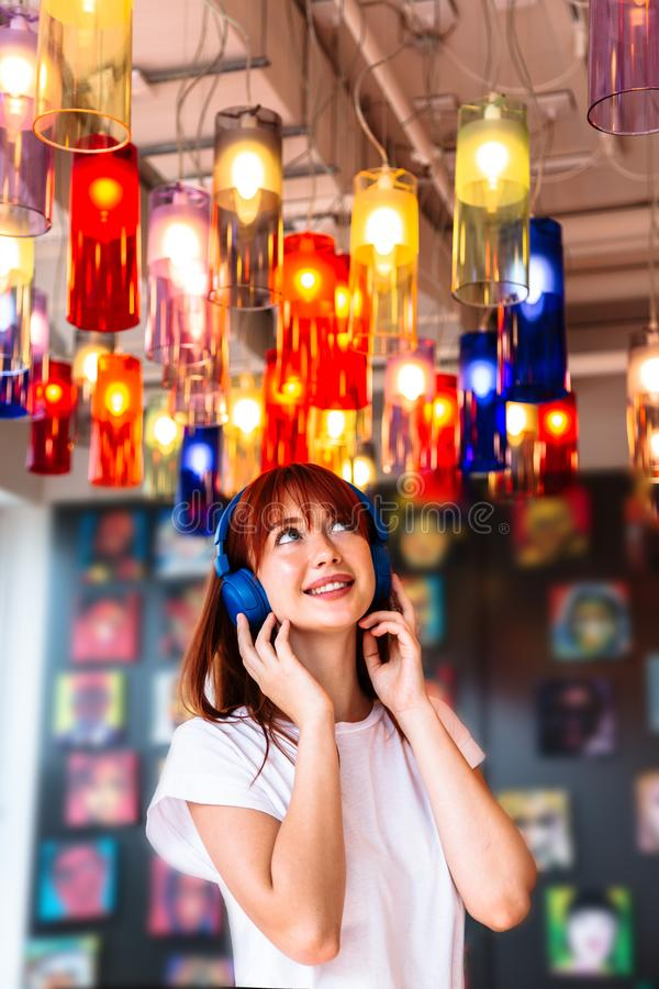 Woman in headphones listening to favourite song royalty free stock photos