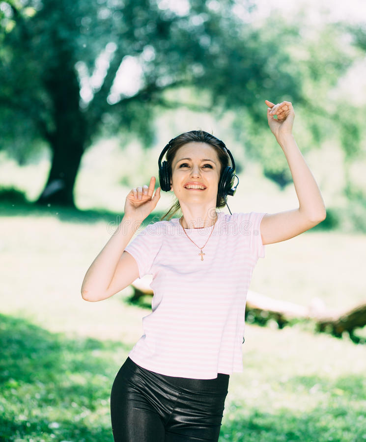 Woman with Headphones Outdoors stock photos