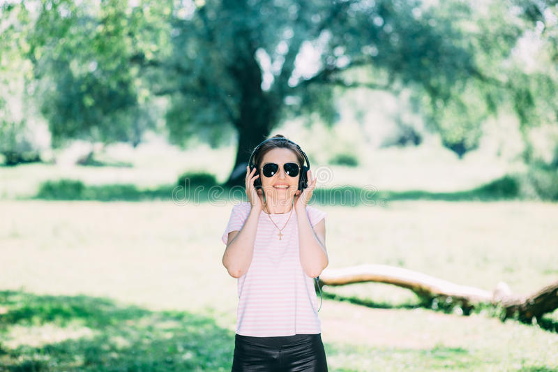 Woman with Headphones Outdoors royalty free stock photography
