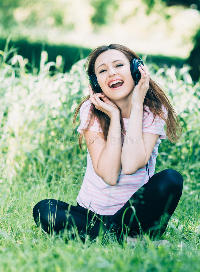 Woman with Headphones Outdoors stock photography
