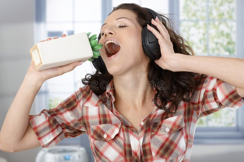 Download Woman With Headphones And Plant Microphone Stock Image - Image: 23375937