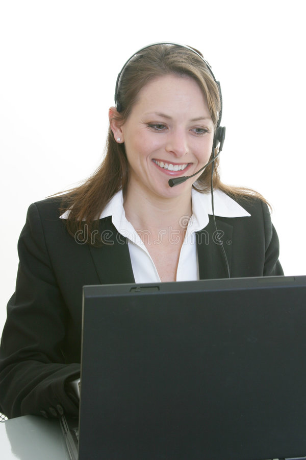 Woman with headset and computer stock photos