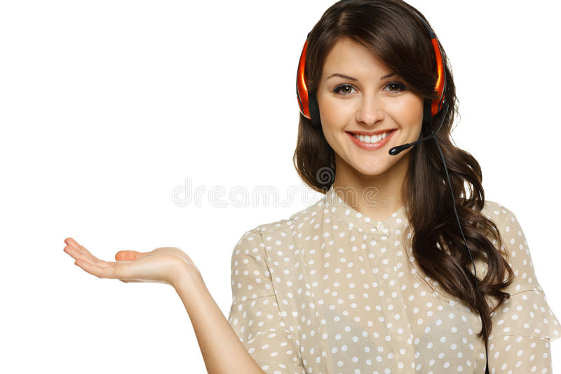 Woman in headset holding empty copy space on her open palm. Smiling cheerful woman in headset holding empty copy space on her open palm, looking at camera royalty free stock photos