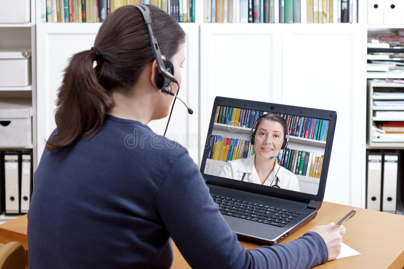 Woman headset video chat doctor royalty free stock photos