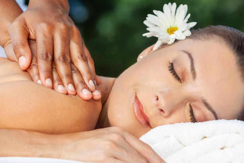 Woman At Health Spa Having Relaxing Massage royalty free stock photography
