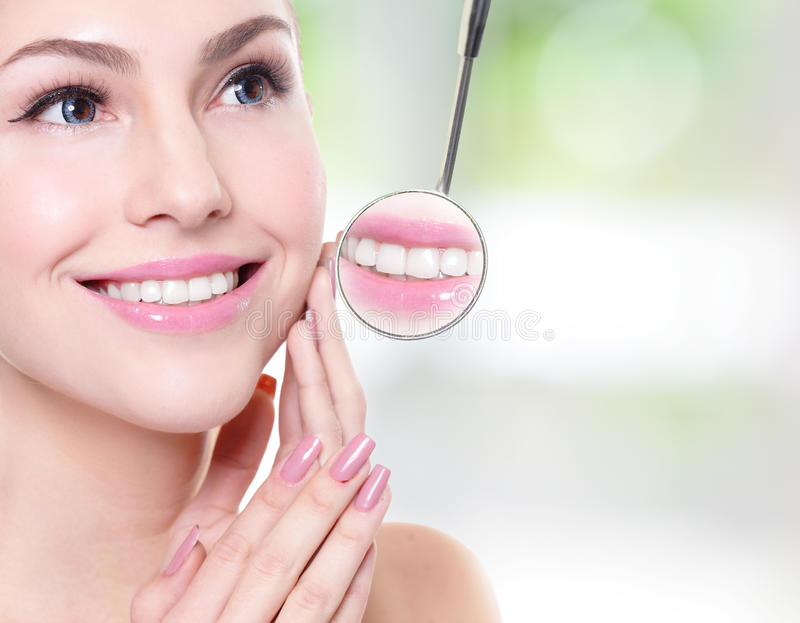 Woman with health teeth and dentist mouth mirror royalty free stock image