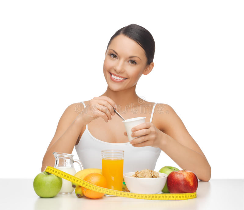 Woman with healthy breakfast and measuring tape. Young woman with healthy breakfast and measuring tape stock image