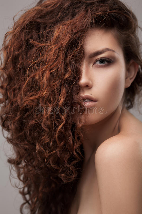 Woman with healthy brown curly hair royalty free stock photos