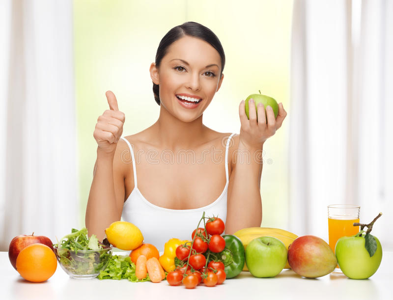 Woman with healthy food. Beautiful woman with healthy food showing thumbs up royalty free stock photo