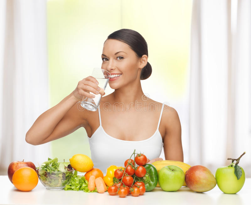 Woman with healthy food. Beautiful woman with healthy food and water royalty free stock photo