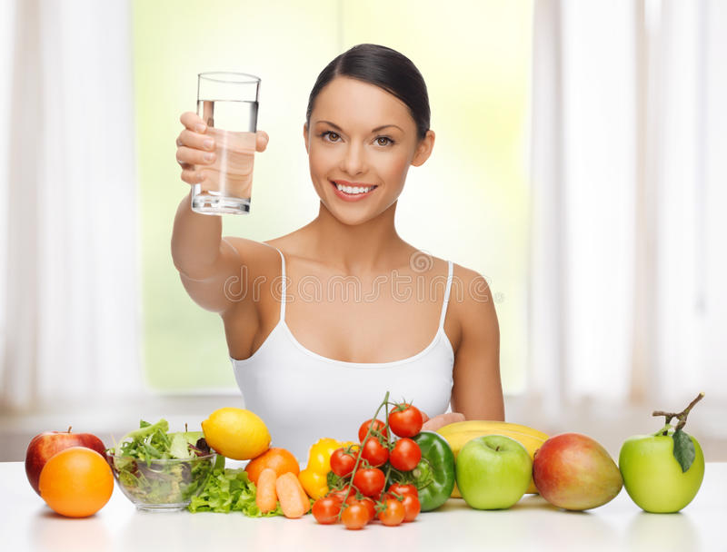 Woman with healthy food. Beautiful woman with healthy food and water stock photography