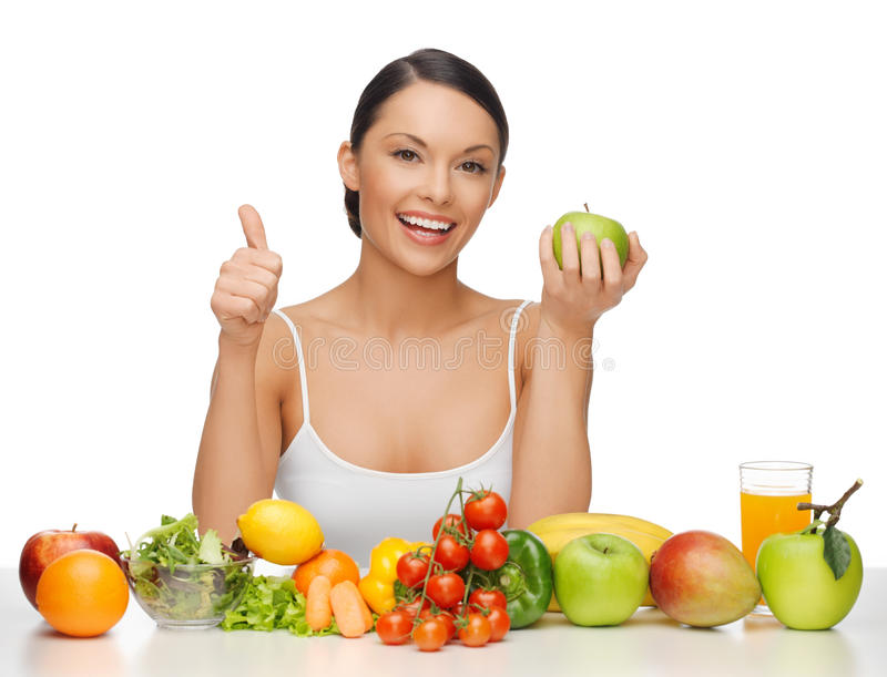 Woman with healthy food. Beautiful woman with healthy food showing thumbs up royalty free stock photography
