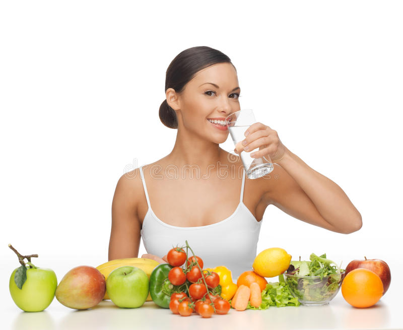 Woman with healthy food. Beautiful woman with healthy food and water royalty free stock images