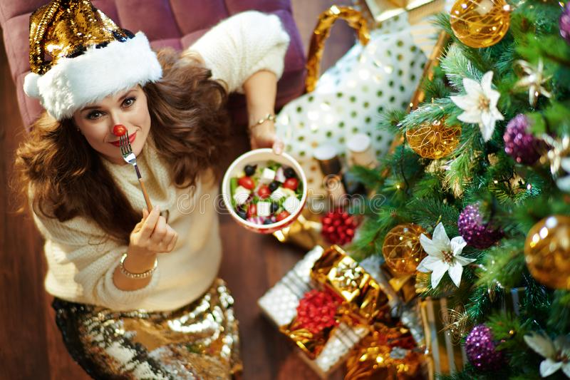 Woman with healthy salad making red nose with cherry tomato royalty free stock photos