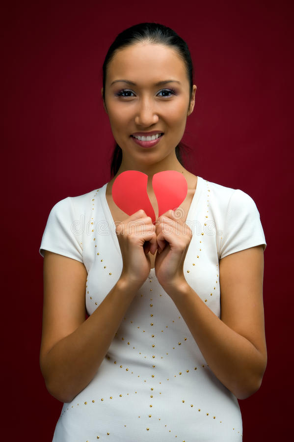 Woman with heart in her hands royalty free stock images