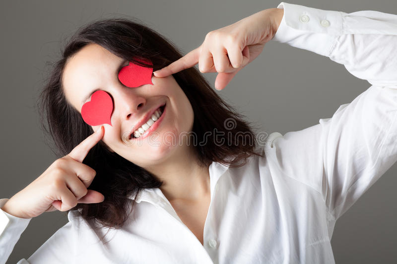 Woman with Hearts on Her Eyes stock photo