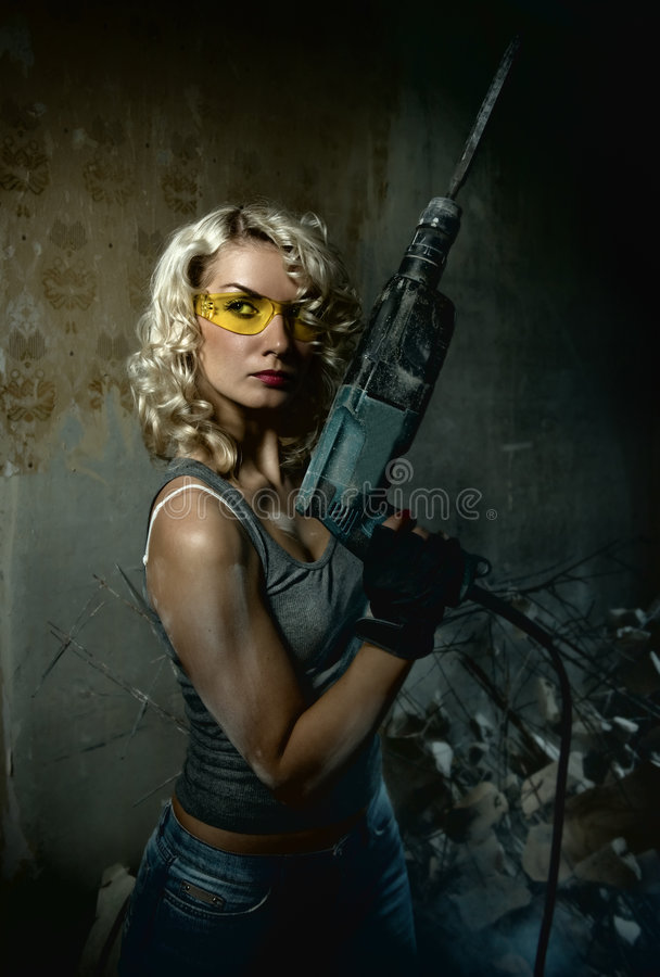 Woman with heavy drill royalty free stock image