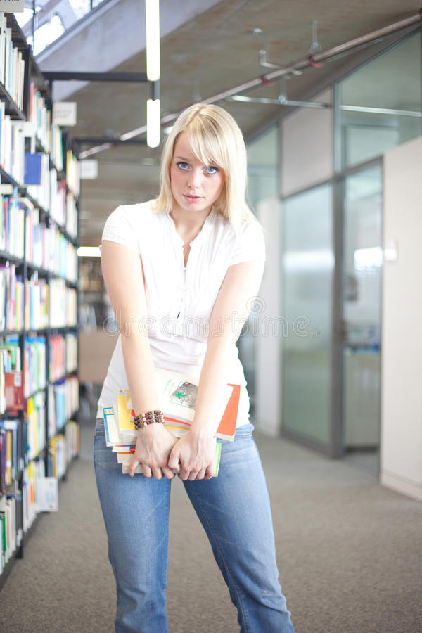 Download Woman With A Heavy Pile Of Books Stock Image - Image of shelf, archive: 21532783
