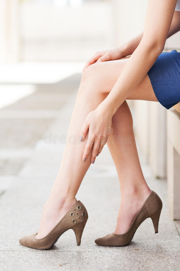 Woman In Heels Massaging Tired Legs Stock Images