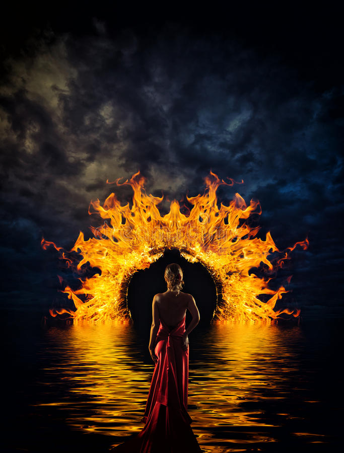 Woman at hell's door stock photography