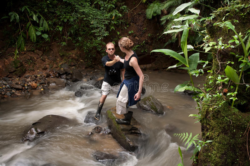 Download Woman Helping Man Cross Costa Rican River Stock Image - Image: 15523675