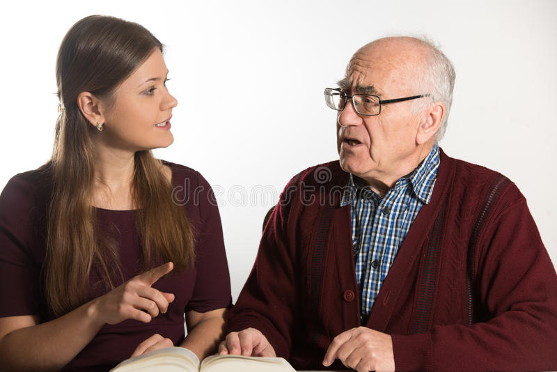 Woman helps senior man royalty free stock photos