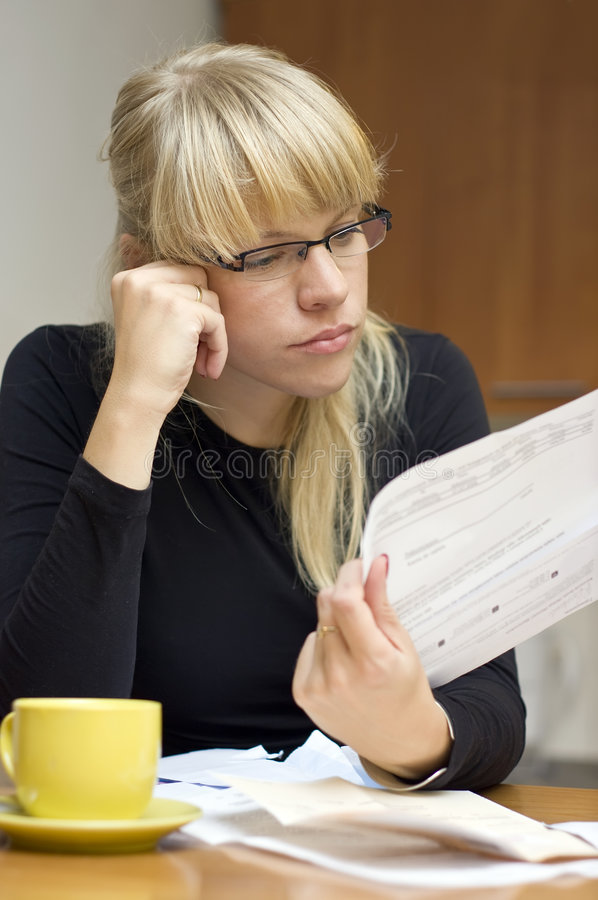 Woman and her bills stock photo