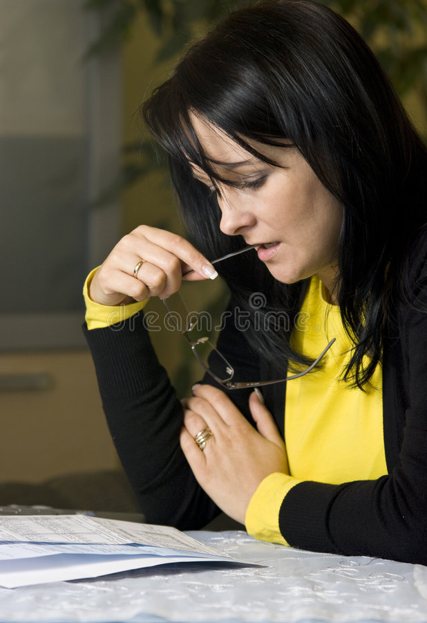 Woman and her bills stock photos