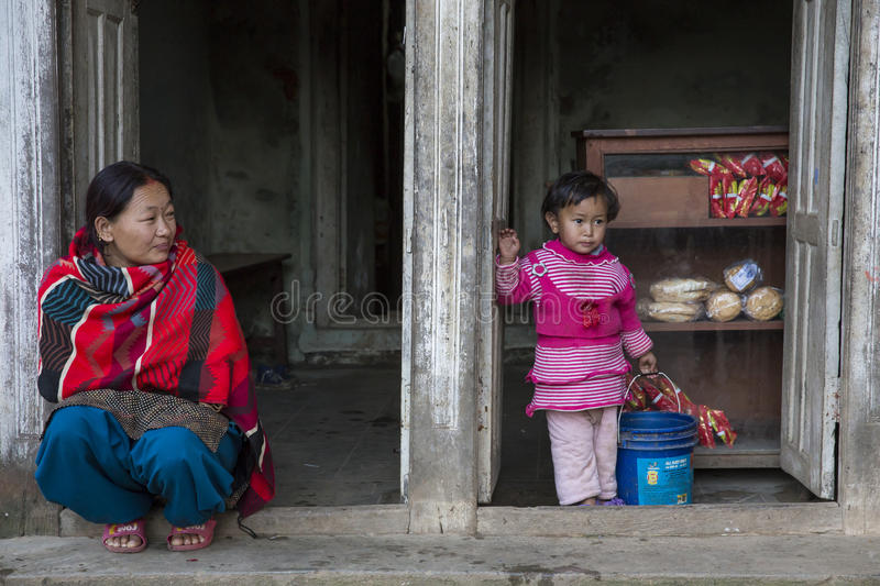A woman with her daughter in Panauti, Nepal royalty free stock images