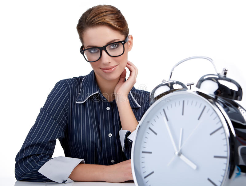 Woman at her desk at the end of the day stock image
