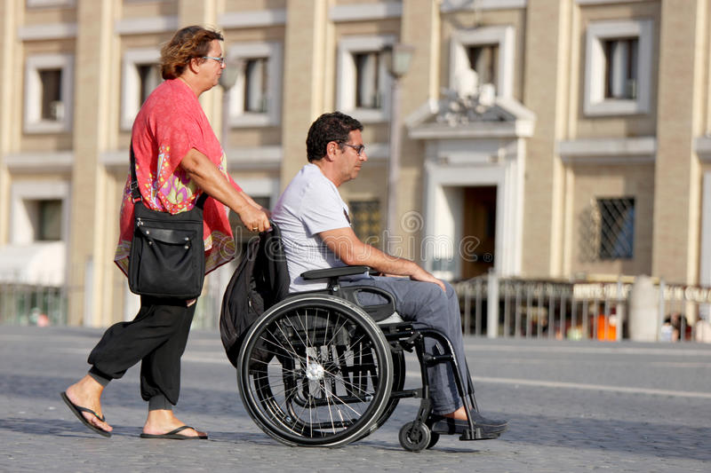 Woman and her disabled husband in the wheelchair stock photography