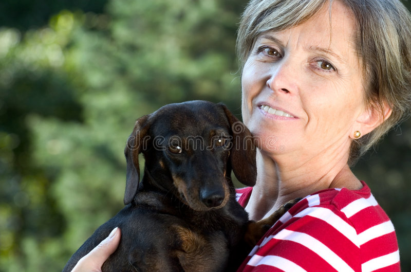 Smiling Mature Mexican Woman With Her Dachshund