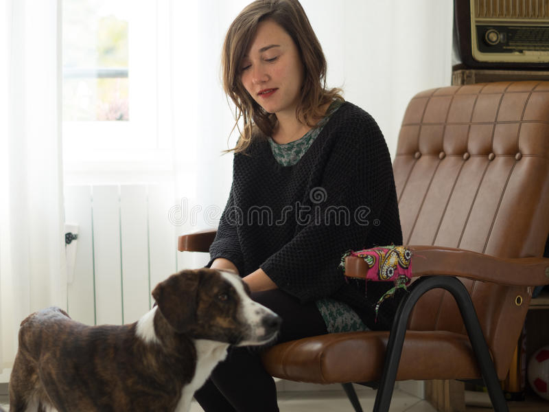 Woman with her dog relaxing stock photo