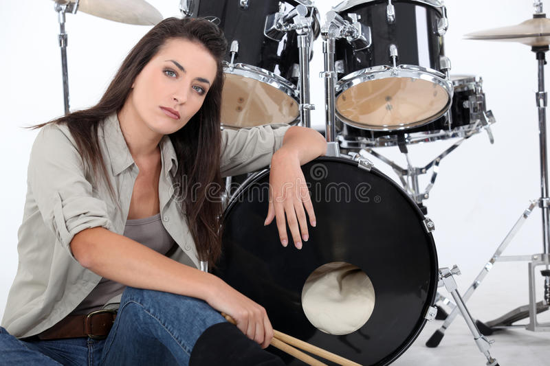 Woman with her drum set royalty free stock photo