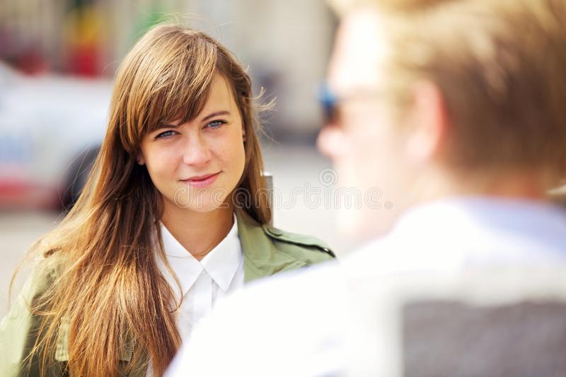 Woman With Her First Date Outdoors Stock Images