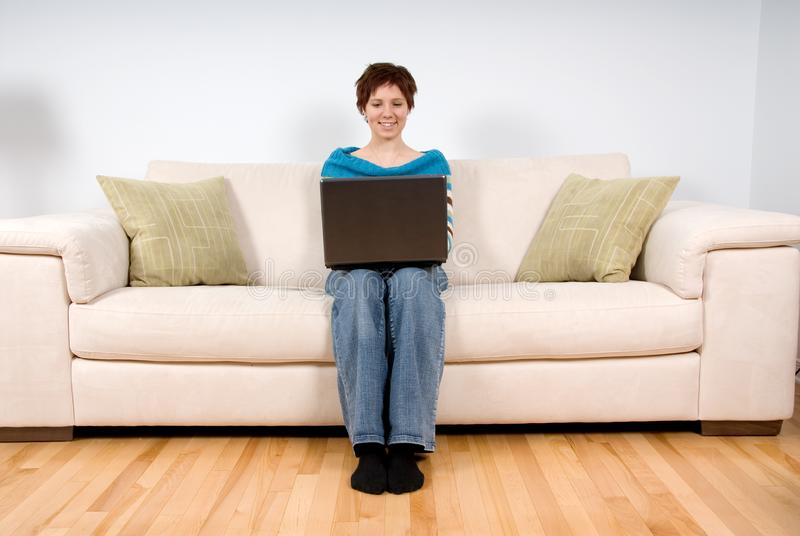 Woman on her laptop royalty free stock photography