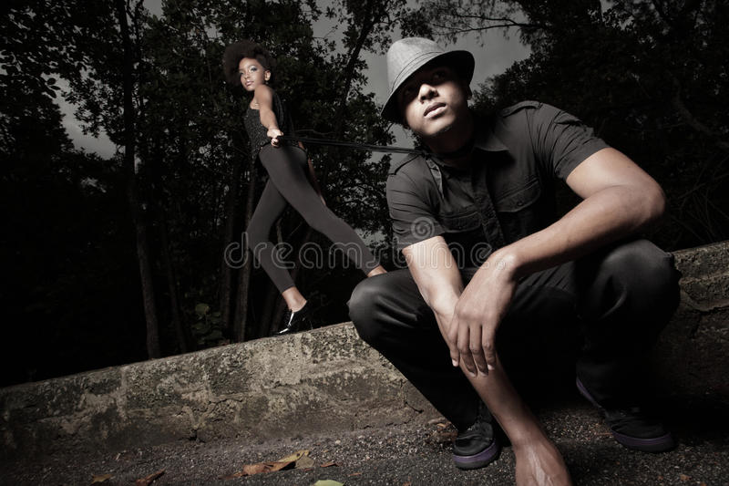 Woman with her man on a leash royalty free stock photos