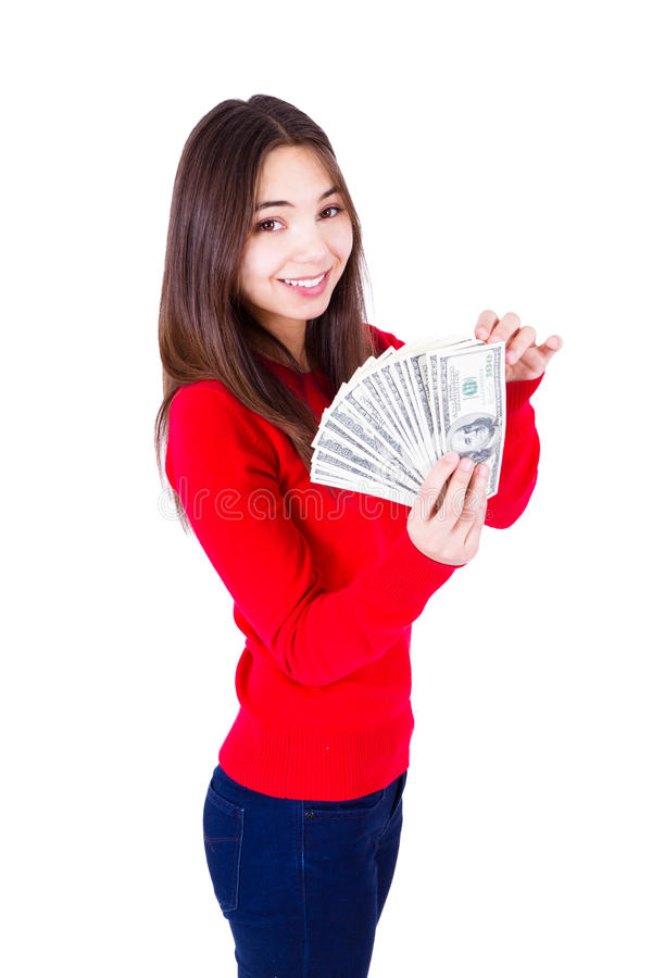 Woman and Her Money. Young woman holding all one hundred dollar banknotes. Slim girl in red catchy sweter and jeans, isolated on white background stock photography