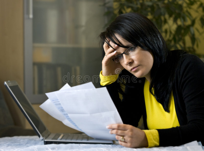 Woman and her monthly bills stock photography