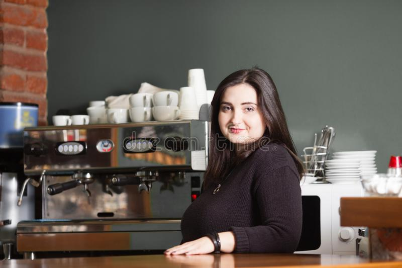 Woman in espresso bar royalty free stock photo